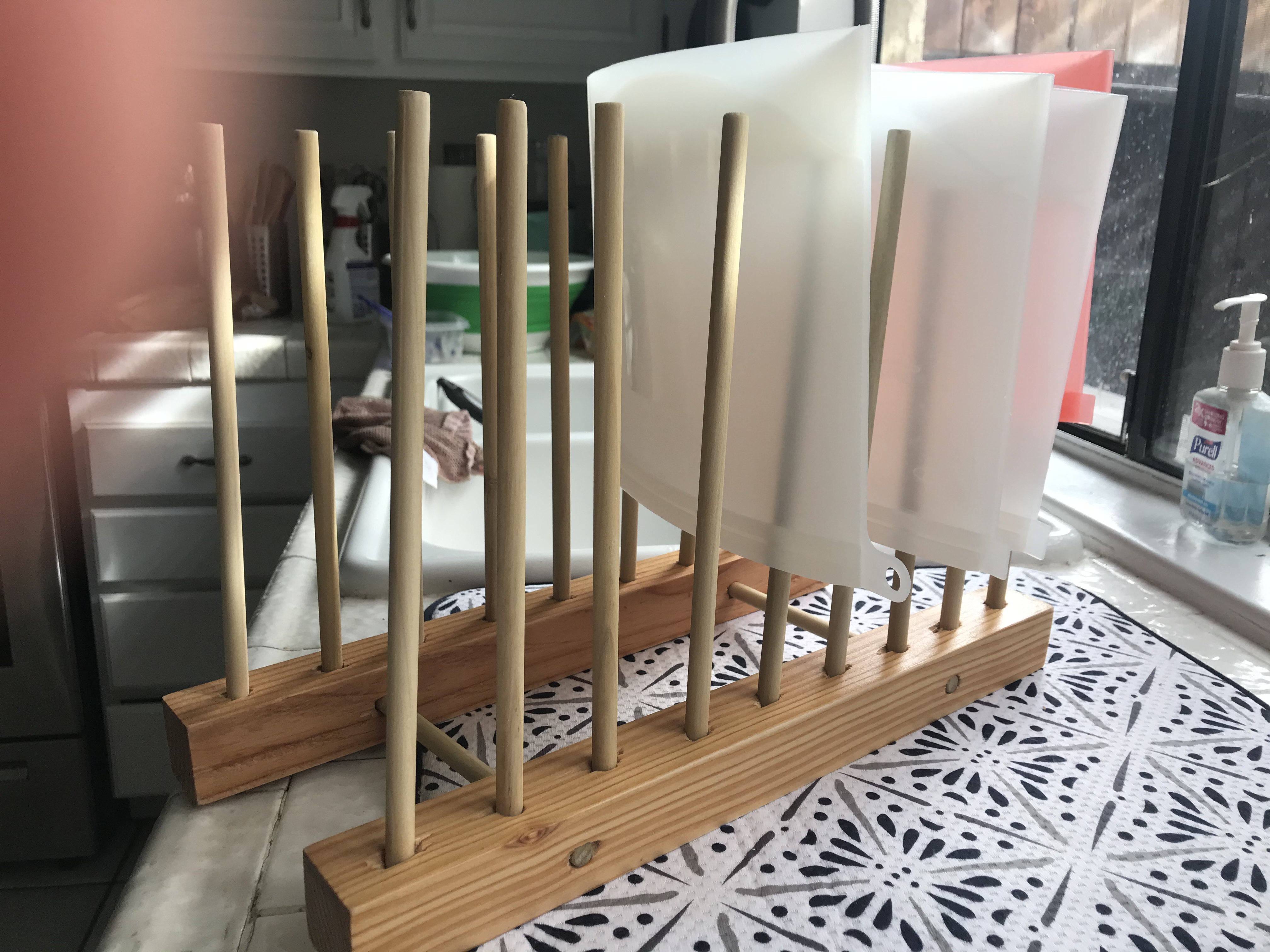 drying rack holding plastic bags up on spindles