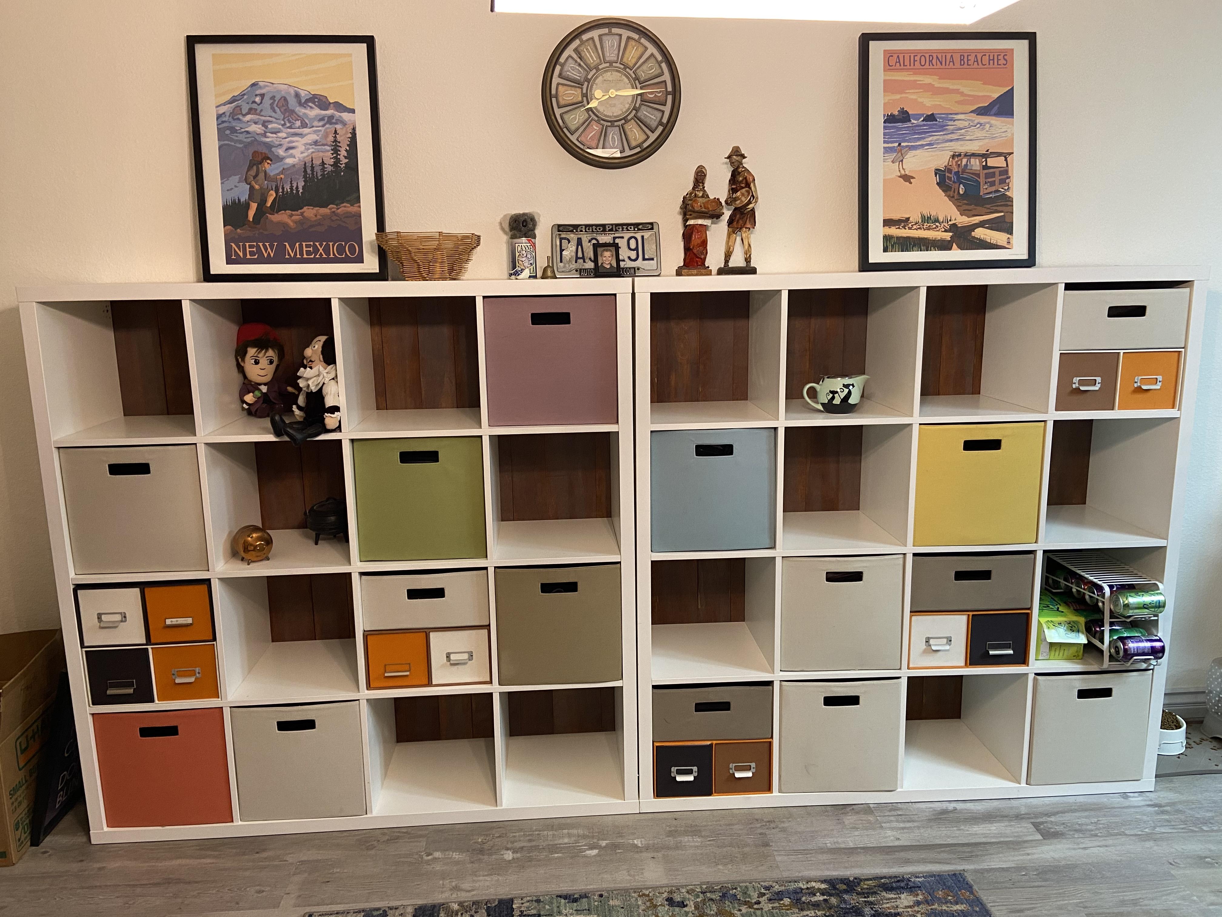 wood panels supporting an Ikea shelving unit